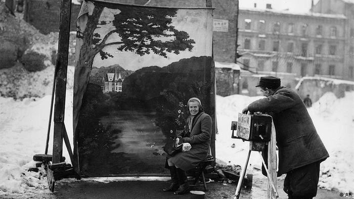 A photographer shooting a portrait in Warsaw in November 1946 (AP)
