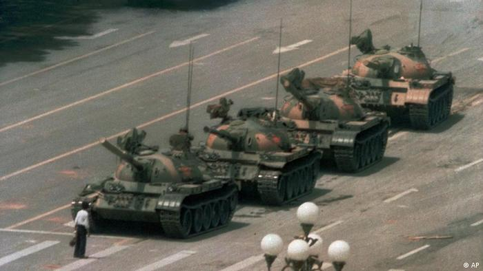 A Chinese man stands alone to block a line of tanks heading east on Beijing's Cangan Blvd. in Tiananmen Square on June 5, 1989. The man, calling for an end to the recent violence and bloodshed against pro-democracy demonstrators, was pulled away by bystanders, and the tanks continued on their way. The Chinese government crushed a student-led demonstration for democratic reform and against government corruption, killing hundreds, or perhaps thousands of demonstrators in the strongest anti-government protest since the 1949 revolution. Ironically, the name Tiananmen means Gate of Heavenly Peace. (AP Photo/Jeff Widener)