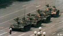 "A Chinese man stands alone to block a line of tanks heading east on Beijing's Cangan Blvd. in Tiananmen Square on June 5, 1989. The man, calling for an end to the recent violence and bloodshed against pro-democracy demonstrators, was pulled away by bystanders, and the tanks continued on their way. The Chinese government crushed a student-led demonstration for democratic reform and against government corruption, killing hundreds, or perhaps thousands of demonstrators in the strongest anti-government protest since the 1949 revolution. Ironically, the name Tiananmen means ""Gate of Heavenly Peace"". (AP Photo/Jeff Widener)"