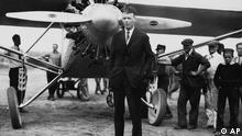 Aviator Charles A. Lindbergh stands in front of his plane The Spirit of St. Louis in New York in 1927 before his historic solo flight to Paris. (AP Photo)