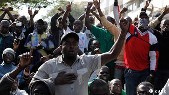 anti-government protesters shout slogans