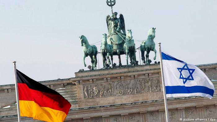 German and Israeli flags with the Brandenburg Gate in the background