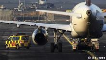 An airport apron controller vehicle is pictured next to a Lufthansa Airbus A321-200 aircraft on the runway at Frankfurt airport February 20, 2012. A stoppage by ground crew at Frankfurt airport, which has grounded hundreds of flights, will continue for a third day on Monday and their union said it was prepared to continue the dispute for weeks. REUTERS/Alex Domanski (GERMANY - Tags: BUSINESS TRANSPORT EMPLOYMENT CIVIL UNREST) eingestellt von qu