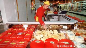 A shop assistant sorts chees at Ashan supermarket in Moscow
