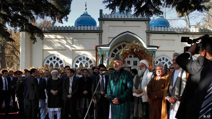 Afghan President Hamid Karzai, center, speaks to media members after offering the Eid al-Adha's prayers at the presidential palace in Kabul, Afghanistan on Tuesday, Nov. 16, 2010. (Photo: AP Photo/Musadeq Sadeq)