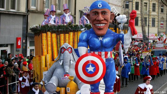 A caricature of US President Barack Obama as captain America appears on a Rose Monday parade float. Photo: Rolf Vennenbernd dpa/lnw +++(c) dpa - Bildfunk+++