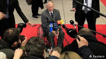 Germany's Finance Minister Wolfgang Schaeuble (C) arrives at a Eurogroup meeting at the European Union council headquarters in Brussels February 20, 2012. Euro zone finance ministers are expected to approve a second rescue package for Greece at a meeting on Monday, a move officials hope will draw a line under four months of social unrest and financial market turmoil that has shaken Athens. REUTERS/Yves Herman (BELGIUM - Tags: BUSINESS POLITICS)