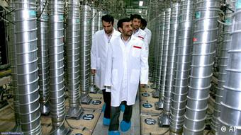 FILE - In this Tuesday, April 8, 2008 file photo released by the Iranian President's Office, Iranian President Mahmoud Ahmadinejad, center, visits the Natanz Uranium Enrichment Facility some 200 miles (322 kilometers) south of the capital Tehran, Iran. The village of Fordo _ which is hailed by Iranians for the greatest per capita losses during the 1980s war with Iraq _ was chosen to symbolize Iran's next move in its nuclear brinksmanship: An underground uranium enrichment site that could begin operations by early next year.(AP Photo/Iranian President's Office, File) NO SALES