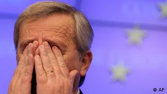 Juncker with hands over his eyes