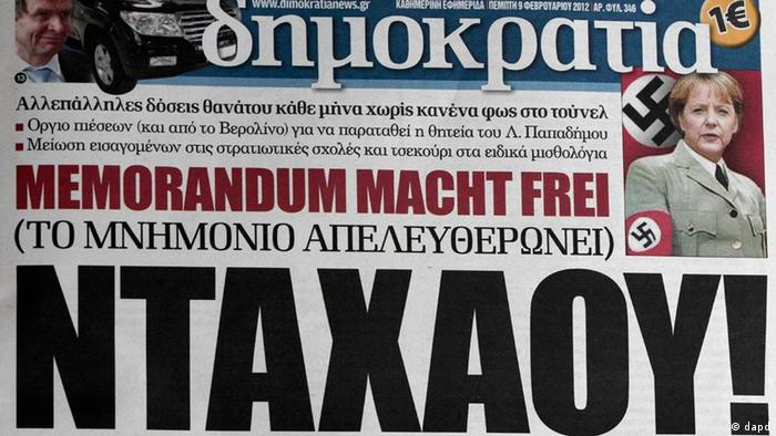 The Greek newspaper Democracy with the main title reading DACHAU and showing German Chancelor Merkel wearing an SS uniform (Dimitri Messinis/AP/dapd)