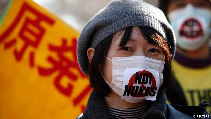 Anti-nuclear protesters attend a rally in Tokyo February 19, 2012. The characters in the background read nuclear power. REUTERS/Yuriko Nakao (JAPAN - Tags: POLITICS CIVIL UNREST ENERGY)