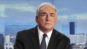 Dominique Strauss-Kahn, former head of the International Monetary Fund, looks on prior to a television interview at the TV news broadcast by French TV station TF1, in Boulogne-Billancourt, outside Paris, Sunday Sept. 18, 2011. Strauss-Kahn has dismissed French writer Tristane Banon's claims that he tried to rape her during a 2003 interview as imaginary and insisted there was no act of aggression, no violence. (ddp images/AP Photo/Francois Guillot, pool)