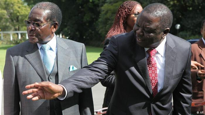 Zimbabwe President Robert Mugabe, left, talks to Morgan Tsvangirai, Zimbabwe Prime Minster after the swearing in ceremony of new ministers at State House in Harare, Thursday, June, 24, 2010. (ddp images/AP Photo/Tsvangirayi Mukwazhi)