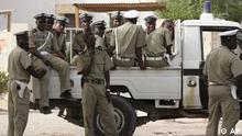 Police seen as they provide security at a voting station in the city of Nouakchott, Mauritania, Sunday, June 25, 2006. Junta-led Mauritania held an extraordinary referendum Sunday giving voters their first-ever chance to place limits on presidential terms through amendments that would enshrine the principal of democratic regime change in the desert nation's constitution. (ddp images/AP Photo/ Schalk van Zuydam)