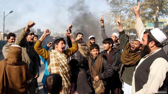 Afghan men shout anti-US slogans during a demonstration in Jalalabad province