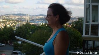 Professor Busra Ersanli standing on a balcony
