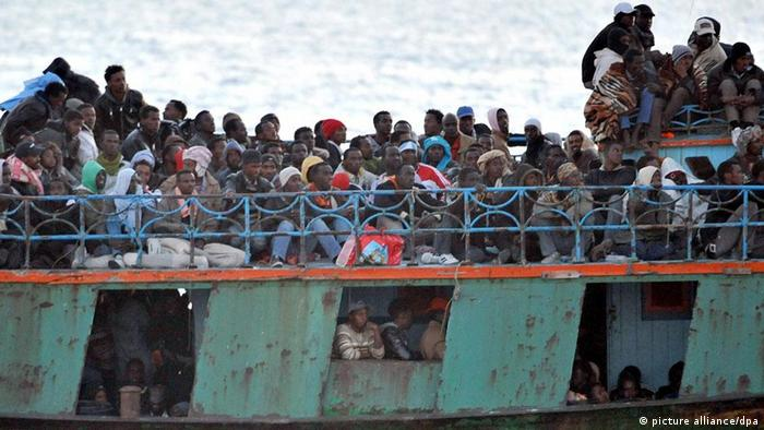 A boat carrying migrants arrives in the port of Lampedusa