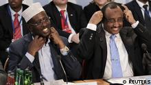 Somalia's President Sheikh Sharif Ahmed (L) and Prime Minister Abdiweli Mohamed Ali attend the Somalia Conference at Lancaster House in London February 23, 2012. Clinton on Thursday threatened sanctions against anyone blocking reforms intended to end Somalia's hopeless, bloody conflict and eradicate militant and pirate groups seen as a growing menace to world security. REUTERS/Matt Dunham/POOL (BRITAIN - Tags: POLITICS)