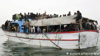 An overcrowded boat with African migrants