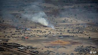 In this photo released by the United Nations Mission in Sudan (UNMIS), homes are seen burning in the town of Abyei, Sudan, Monday, May 23, 2011.