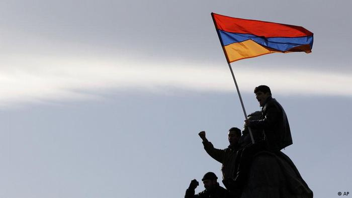 Opposition supporters wave an Armenian flag during a rally in Yerevan, Thursday, Feb. 21, 2008. Thousands of opposition supporters rallied for a second straight day in Armenia's capital Thursday, claiming the presidential election was rigged and vowing to protest until a new vote is held. (AP Photo/Misha Japaridze)