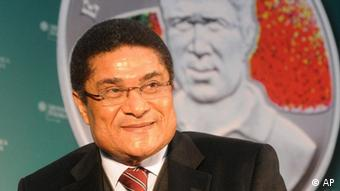 Portuguese soccer legend Eusebio da Silva Ferreira smiles during a press conference presenting a new coin depicting him, in Warsaw, Poland, Wednesday, Nov. 26, 2008. The coin is a part of a series of special coins called The Kings of Football and dedicated to the most famous soccer players in the world. The coins with a nominal value of 100 Armenian Drams, or 33 US cents are produced by the Mint of Poland for the Central Bank of the Republic of Armenia. About 20 more coins will be released in the series next year. (ddp images/AP Photo/Alik Keplicz)