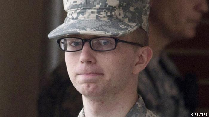Bradley Manning is escorted by military police at Fort Meade, Maryland, December 21, 2011