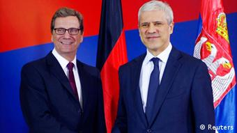 Serbia's President Boris Tadic (R) and Germany's Foreign Minister Guido Westerwelle