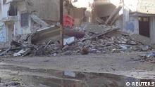 منطقه مسکونی باباعمرو در شهر حمص زیرآتش خمپاره و گلولههای تانک قرار دارد