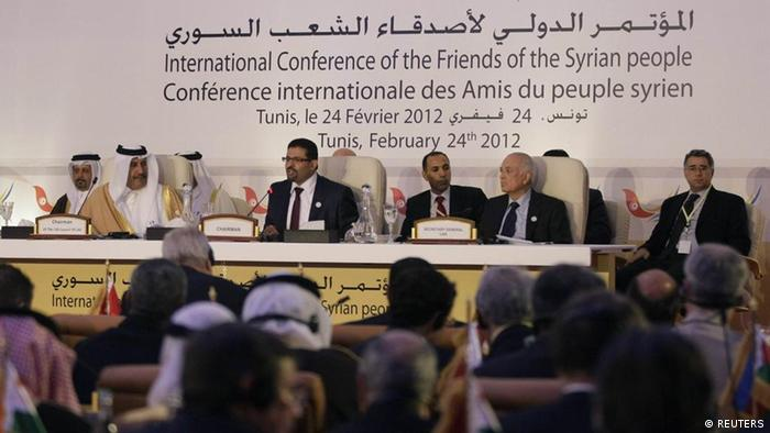 Tunisia's Foreign Affairs Minister Rafik Abdessalem (C) addresses the Friends of Syria Conference in Tunis, February 24, 2012. Western and Arab nations meeting on Friday will demand that Syria implement an immediate ceasefire to allow aid in for desperate civilians in the absence of an international consensus on intervention to end a crackdown on an 11-month-old revolt. REUTERS/Jason Reed (TUNISIA - Tags: POLITICS)