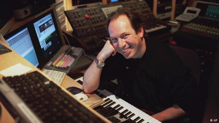 Hans Zimmer sits at a keyboard in a production studio, (AP)