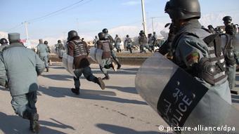 Riot police run to disperse anti-US protestors