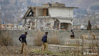 Policemen stand guard near the partially demolished compound where al Qaeda leader Osama bin Laden was killed by US special forces last May, in Abbottabad February 26, 2012 (Photo: REUTERS/Faisal Mahmood)