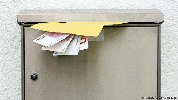 Banknotes in a letter box