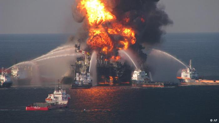 Fire boat response crews spray water on the burning remnants of BP's Deepwater Horizon offshore oil rig