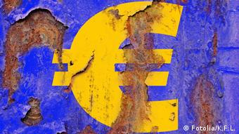 A peeling painted euro sign Copriyght: Fotolia/K.F.L. #23434670