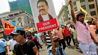 A Sri Lankan boy displays a cutout of President Mahinda Rajapaksa during a street march, in Colombo, Sri Lanka, Monday, Feb. 27, 2012 (Photo:Gemunu Amarasinghe/AP/dapd)