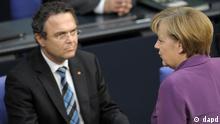 آنگلا مرکل، صدراعظم آلمان، در گفتوگو با هانس پتر فریدریش، وزیر کشور آلمان