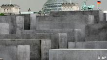 ** FILE** The concrete slabs of Germany's national Holocaust memorial sit in front of the Reichstag dome and the four-horsed chariot on top of the Brandenburg Gate, right, in Berlin, in this May 3, 2005 file photo. The Memorial to commemorate the 6 million Jews who died at the hands of the Nazis is due to be opened on May 10, 2005. Some see a sign of the new Germany in the architecture in Berlin, where the government moved from the Cold War capital of Bonn in 1999. Bonn's small-town modesty contrasts sharply with the sprawling concrete and glass palaces built for the chancellor and legislature in reunified Berlin.(AP Photo/Herbert Knosowski)