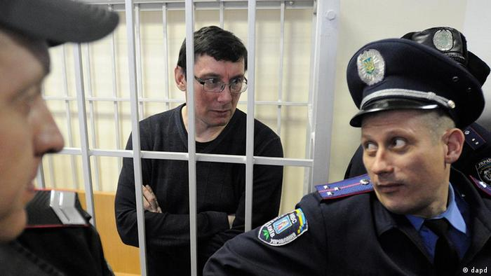 Former Ukrainian Interior Affair Minister Yuri Lutsenko is seen in a detention cage in a courtroom, in Kyiv, Ukraine