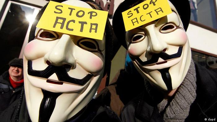 Anti-ACTA Demonstration in Düsseldorf with two people donning Guy Fawkes masks