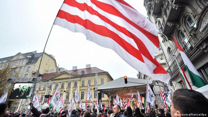 Supporters of Jobbik wave a huge historical red-and-white flag during a demonstration EPA/ZOLTAN MATHE