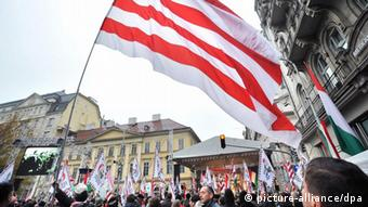 The radical nationalist party For A Better Hungary Movement 'Jobbik' wave a huge historical red-and-white Arpad Stripes flag