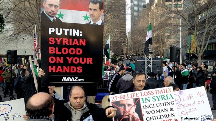 Demonstrators demand action on Syria in front of the UN headquarters in New York