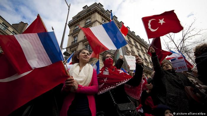 Franco-Turkish demonstrators wave French and Turkish flags as they protest against a senate vote on a bill making it illegal to deny that the killing of Armenians by Ottoman Turks nearly a century ago was a genocide, near the French Senate in Paris, France, 23 January 2012. The French government on 23 Janaury appealed for restraint following fresh threats from Turkey of reprisals if the Senate in Paris passes a bill making it a crime to deny that Armenians suffered 'genocide' at the hands of Ottoman Turks. The Senate is scheduled to begin debating the bill in the mid-afternoon (1400 GMT) and hold a vote in the early evening. EPA/IAN LANGSDON
