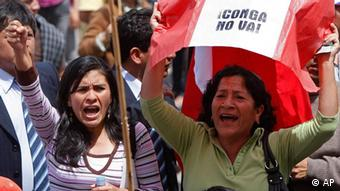 Demonstrators shout slogans against the Conga gold and silver mining project during a protest in Cajamarca, Peru