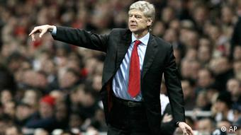 Arsenal's manager Arsene Wenger reacts as he watches his team play against Queens Park Rangers during their English Premier League soccer match at Emirates Stadium, London, Saturday, Dec. 31, 2011. (AP Photo/Sang Tan)