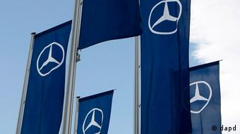 ** FILE ** In this Nov. 3, 2008 file photo, the Mercedes star, logo of Mercedes-Benz cars, is seen on flags in front of the Mercedes-Benz museum in Stuttgart, Germany. Abu Dhabi is poised to become the biggest shareholder in Daimler AG after the German maker of luxury cars, buses and trucks said it would sell nearly euro2 billion in shares to the country's Aabar Investments PJSC. In a statement released Sunday, March 22, 2009, by the Stuttgart-based company, Daimler said Aabar will buy 96.4 million new Daimler shares at a price of euro20.27 (US$27.87) each, which is slightly below the euro21.34 shares fetched at the close of trading Friday in Frankfurt. (ddp images/AP Photo/Thomas Kienzle)