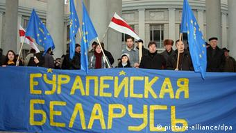 protesters holding EU flags and pro-accession banner