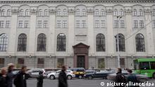 epa02973581 People walk in front of the Belarussian National Bank building in Minsk, Belarus, 20 October 2011. The Belarussian National Bank set a single exchange rate on Thursday. EPA/TATYANA ZENKOVICH
